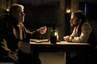 Ron Perlman as Father Duffy and Dominic Monaghan as Arthur Blake in