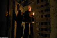 Ron Perlman as Father Duffy in