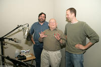 Director Bob Peterson, actor Ed Asner and director Pete Docter on the set of