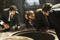 Pierfrancesco Favino as Inspector Olivetti, Ayelet Zurer as Vittoria Vetra, Tom Hanks as Robert Langdon and David Pasquesi as Claudio Vincenzi in