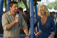 Gerard Butler as Mike and Katherine Heigl as Abby in