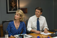 Cheryl Hines as Georgia and John Michael Higgins as Larry in