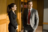 Sandra Bullock as Margaret and Ryan Reynolds as Andrew in