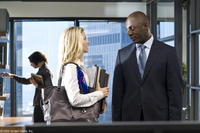 Ali Larter as Lisa and Idris Elba as Derek in