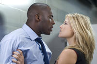 Idris Elba as Derek and Ali Larter as Lisa in