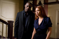 Idris Elba as Derek and Beyonce Knowles as Sharon in