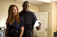 Beyonce Knowles as Sharon and Idris Elba as Derek in