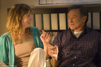 Alexie Gilmore as Claire and Robin Williams as Lance in