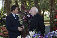 Tim Daly as Bryan Becket and Robert Prosky as Father Wymond in