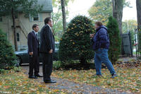 Tim Daly, Tom Arnold and director Tennyson Bardwell on the set of