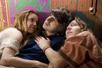 Kelli Garner, Demetri Martin as Elliot Tiber and Paul Dano in