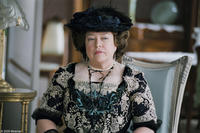 Kathy Bates as Charlotte Peloux in
