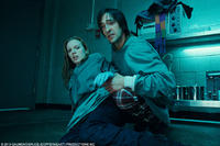 Sarah Polley as Elsa and Adrien Brody as Clive in