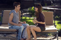 Dustin Milligan as Brad and Kristen Wiig as Suzie in