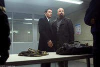 Jonathan Rhys Meyers as James Reese and John Travolta as Charlie Wax in