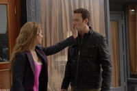 Nia Vardalos as Genevieve and John Corbett as Greg in