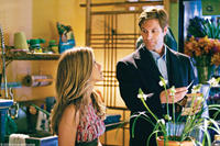 Jennifer Aniston as Eloise and Aaron Eckhart as Burke in