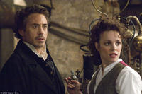 Robert Downey Jr. as Sherlock Holmes and Rachel McAdams as Irene Adler in