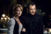 Kelly Reilly as Mary and Jude Law as Dr. Watson in
