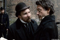 Eddie Marsan as Inspector Lestrade and Robert Downey Jr. as Sherlock Holmes in