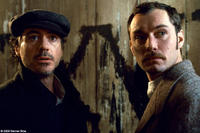 Robert Downey Jr. as Sherlock Holmes and Jude Law as Dr. Watson in