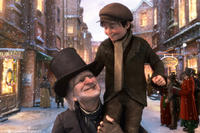 Ebenezer Scrooge (voice of Jim Carrey) and Tiny Tim (voice of Gary Oldman) in