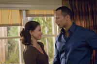 Ashley Judd as Carly and Dwayne Johnson as Derek in