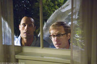 Dwayne Johnson as Derek and Stephen Merchant as Tracy in