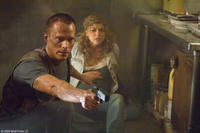 Paul Bettany as Michael and Adrianne Palicki as Charlie in
