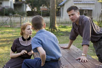 Jessica Chastain as Mrs. O'Brien, Tye Sheridan and Brad Pitt as Mr. O'Brien in ``The Tree of Life.''