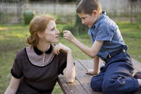 Jessica Chastain as Mrs. O'Brien and Tye Sheridan in ``The Tree of Life.''