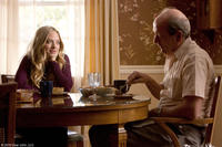 Amanda Seyfried as Savannah and Richard Jenkins as Mr. Tyree in