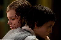 Chloe Grace Moretz as Abby and Kodi Smit-McPhee as Owen in
