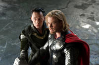 Tom Hiddleston as Loki and Chris Hemsworth as Thor in