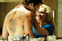 Sullivan Stapleton as Craig Cody and Jacki Weaver as Janine