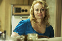 Jacki Weaver as Janine