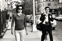 Jacqueline Kennedy Onassis and Ron Galella in