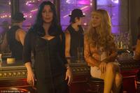 "Cher as Tess and Christina Aguilera as Ali in ""Burlesque."""