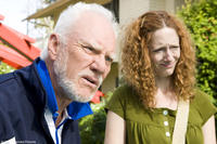 Malcolm McDowell as Mr. Farley and Judy Greer as Ginger in