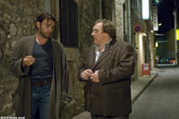 Clovis Cornillac as Jacques Lebas and Gerard Depardieu as Paul Bellamy in