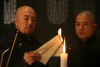 Tielin Zhang as Master Kang and Aaron Kwok in ``Empire of Silver.''