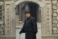 Tielin Zhang as Master Kang in ``Empire of Silver.''