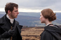 Jamie Bell as St. John and Mia Wasikowska as Jane Eyre in ``Jane Eyre.''