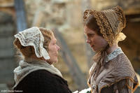 Judi Dench as Mrs. Fairfax and Mia Wasikowska as Jane Eyre in ``Jane Eyre.''