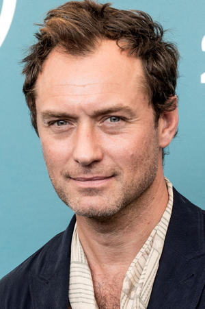 Jude Law as Alan Krumwiede