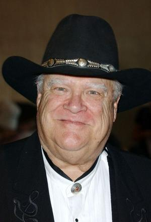 David Huddleston as Olson Johnson