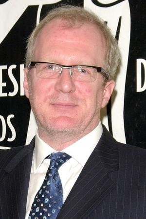 Tracy Letts as John Finlator