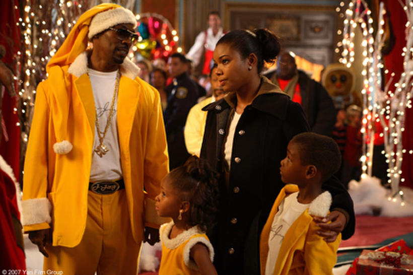 """Charlie Murphy and Gabrielle Union in """"The Perfect Holiday."""""""