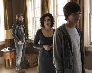 "Scott Speedman as Tom, Arsinee Khanjian as Sabine and Devon Bostick as Simon in ""Adoration."""