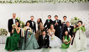"Peter Kim, Greg Paik, Angela Oh, Charles Kim, Brian Tee, Connie Kim, Hee-jung Park, Youngjoo Ko, Bobby Lee, Joy Osmanski, Julia Cho, Kelvin Han Yee and Nancy J. Lee in ""Wedding Palace."""